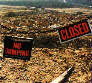 industrial waste showing sign that says no dumping